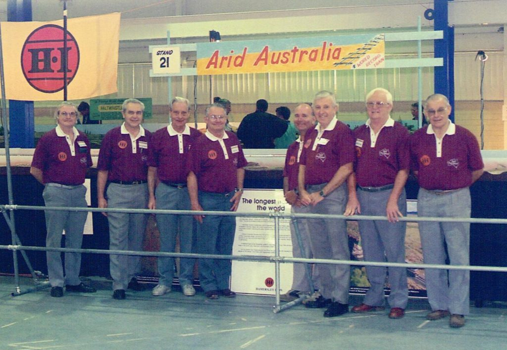 Most of the Arid Australia team at the 1996 AMRA Exhibition - Norm Chapple, (left), Don Finlayson, Len Hughes, Tony Gray, Kim Miller, Ian Rourke, Brian Few and Peter Scarfe.  Not present in the photo - Henry Brooks and Peter Tullis. Photo taken on June 03 1996 - courtesy Don Finlayson.